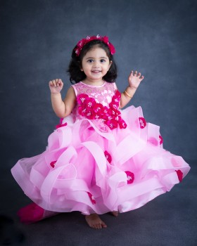 Baby Pink Twirl Flouncy Gown With Frilled Layerd Trail On Back Side